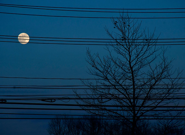 1/9/2020 Mike Orazzi | Staff The nearly full Wolf Moon rises over Bristol on Thursday evening.