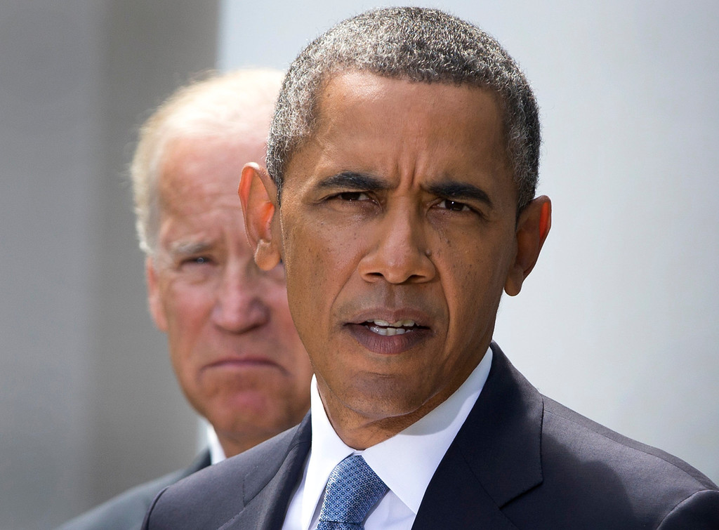 """. President Barack Obama, flanked by Vice President Joe Biden, talks about the crisis in Syria to media gathered in the Rose Garden of the White House Saturday, Aug. 31, 2013, in Washington. Delaying what had loomed as an imminent strike on Syria for its alleged use of chemical weapons, Obama announced Saturday that he wanted to put the matter before Congress first. He said, \""""I know that the country will be stronger if we take this course and our actions will be even more effective.\"""" His remarks were televised live in the United States as well as on Syrian state television with translation.  (AP Photo/Evan Vucci)"""