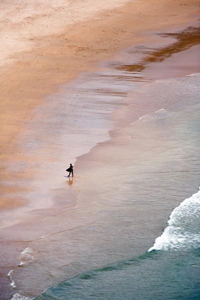 Surfer, Amoreira beach, town of Aljezur, district of Faro, region of Algarve, southwestern Portugal