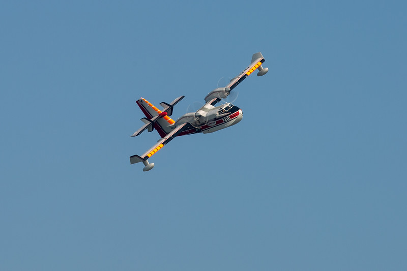 A scooper plane flying above Lake Mendocino Thursday afternoon. Chris Pugh-Ukiah Daily Journal.