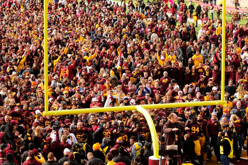 """. <p><b> Delirious Minnesota Gophers fans stormed the TCF Bank Stadium field on Saturday because the Gophers � </b> <p> A. Upset Nebraska for the first time since 1960 <p> B. Won their second consecutive Big Ten game <p> C. Earned a berth in the Who Gives a Rat�s Ass Bowl <p><b><a href=\'http://www.twincities.com/sports/ci_24393675/gophers-lead-nebraska-17-13-at-halftime\' target=\""""_blank\"""">HUH?</a></b> <p>      (Pioneer Press: Scott Takushi)"""