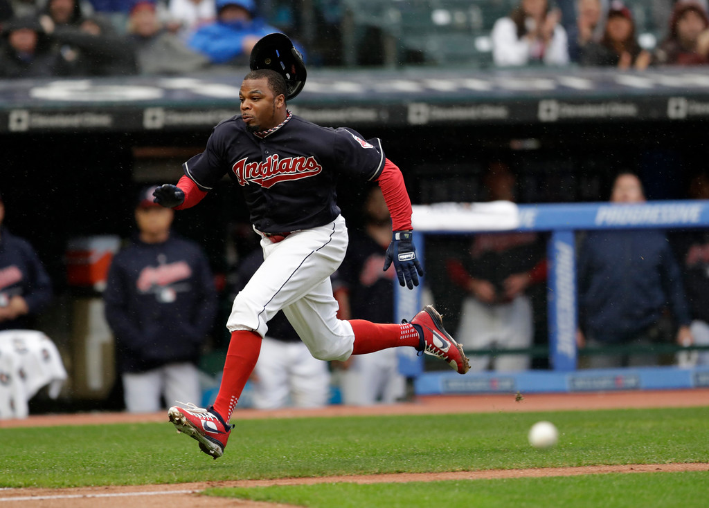 . Cleveland Indians\' Rajai Davis runs towards home plate in the third inning of a baseball game, Tuesday, April 24, 2018, in Cleveland. Davis was tagged out by Chicago Cubs catcher Willson Contreras. (AP Photo/Tony Dejak)
