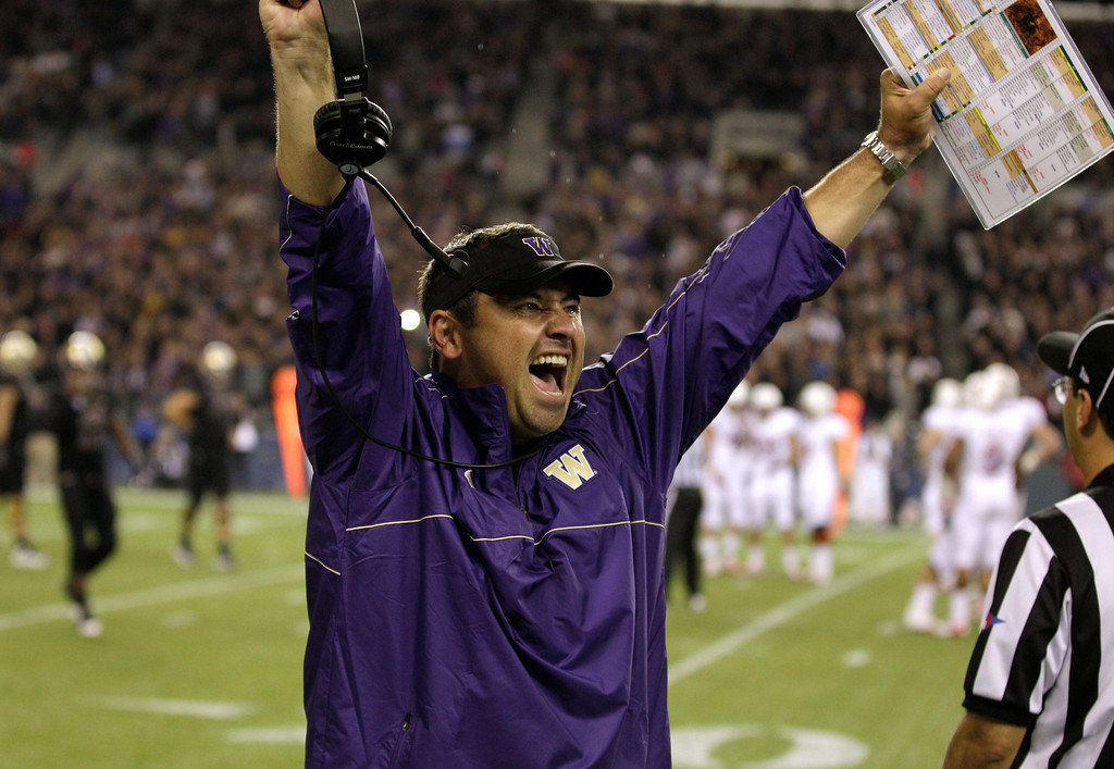 . Washington head coach Steve Sarkisian celebrates a play late in an NCAA college football game against Stanford, Thursday, Sept. 27, 2012, in Seattle. Washington beat Stanford, 17-13. (AP Photo/Ted S. Warren)
