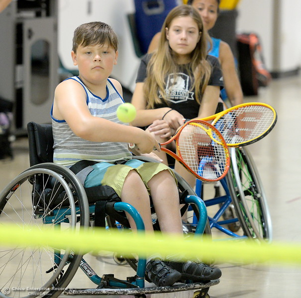 11-year-old Kanon Aiono of Sacramento eyes the ball as he plays some tennis during the Ability First Camp for kids with disabilities at CSUC Tuesday June 20, 2017. (Bill Husa -- Enterprise-Record)