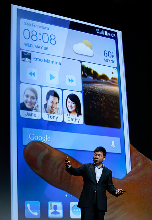 . Huawei Consumer Business Group CEO Richard Yu discusses features of the Ascend Mate 2 4G smartphone during the International Consumer Electronics Show, Monday, Jan. 6, 2014, in Las Vegas. (AP Photo/Julie Jacobson)