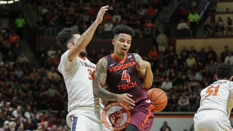 Seth Allen gets the ball knocked away from him by UVa's London Perrantes. (Mark Umansky/TheKeyPlay.com)