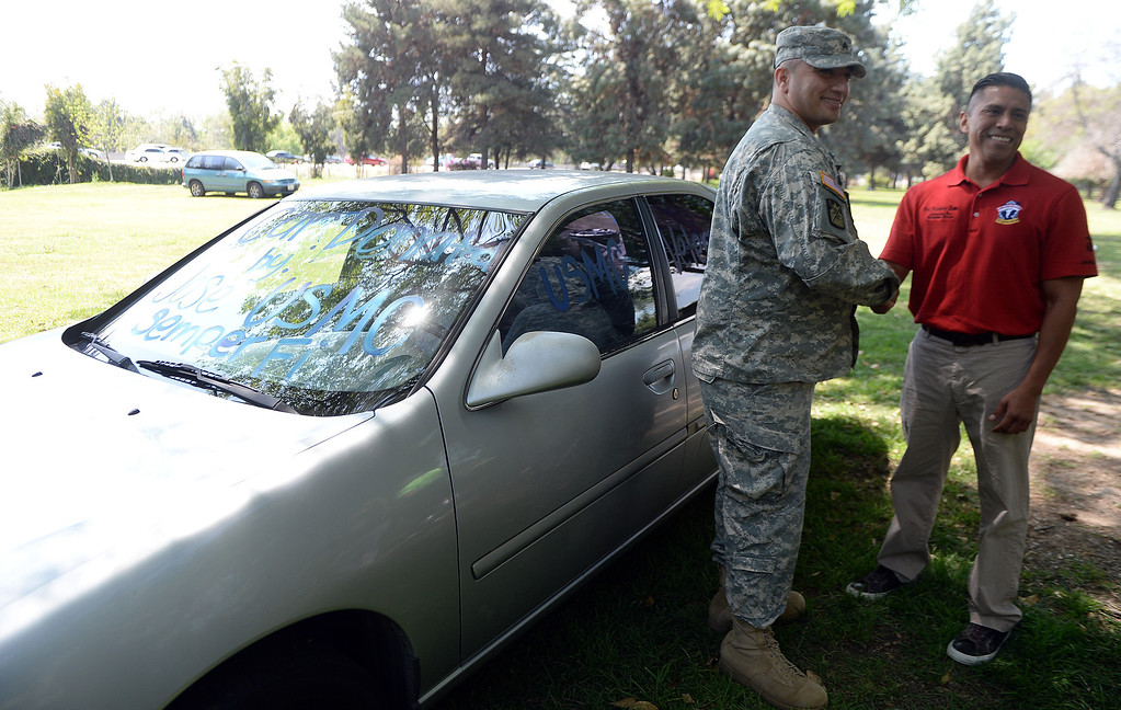 . Jose Gonzalez, right, shakes hands with U.S. Army Sgt. Diego Rodriguez of West Covina after donating the car to Rodriguez during �Heroes in the Shadows� San Gabriel Valley Homeless Stand Down, A three day event presented by The Vet Hunters Project and The SGV Veterans Employment Committee aims to combat Homelessness by providing on site assistance, services and resources to those in need at Whittier Narrows Recreation Park in South El Monte, Calif., on Saturday, April 5, 2014.  (Keith Birmingham Pasadena Star-News)