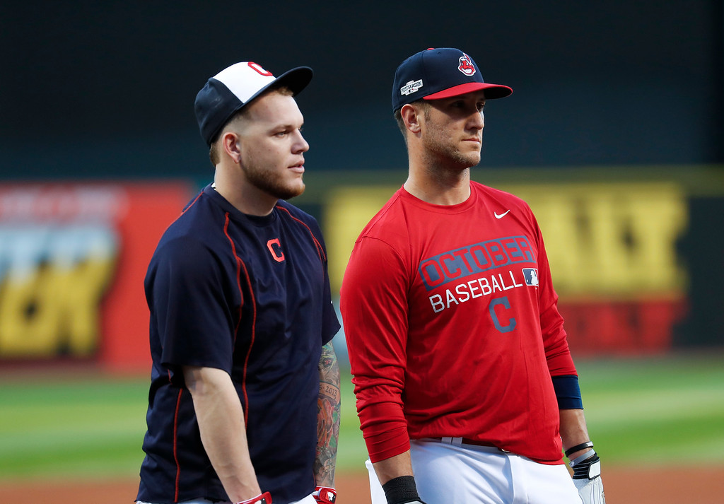 . Cleveland Indians catcher Roberto Perez, left, and catcher Yan Gomes watch during practice in Cleveland, Wednesday, Oct. 5, 2016. Cleveland meets the Boston Red Sox in Game 1 of baseball\'s American League Division Series Thursday. (AP Photo/David Dermer)