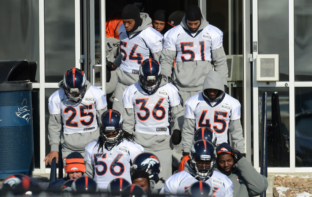 . Players heading to the practice field of Denver Broncos Headquarters at Dove Valley in Englewood, Colorado on Friday,  December 6, 2013. (Photo by Hyoung Chang/The Denver Post)