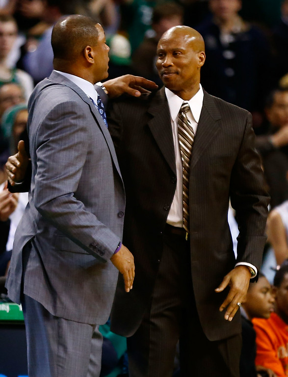 . Head coaches Doc Rivers of the Boston Celtics and Byron Scott of the Cleveland Cavaliers greet following their game on December 19, 2012 at TD Garden in Boston, Massachusetts.  (Photo by Jared Wickerham/Getty Images)