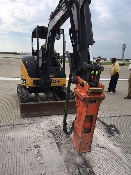 NPK GH1 hydraulic hammer on Deere 35G mini excavator - Murphy doing repairs at Cleveland airport 2017 (2).jpg