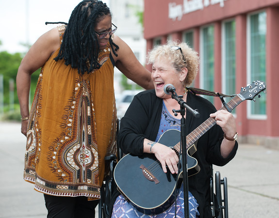 05/17/18 Wesley Bunnell | Staff The New Britain Artists' Co-op held open mic outdoors on Thursday night at KC's on Main. Artist Leslie Manselle sings along with Jill Free to start off the event.