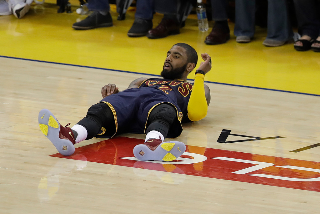 . Cleveland Cavaliers guard Kyrie Irving (2) lies on the court during the first half of Game 1 of basketball\'s NBA Finals against the Golden State Warriors in Oakland, Calif., Thursday, June 1, 2017. (AP Photo/Marcio Jose Sanchez)