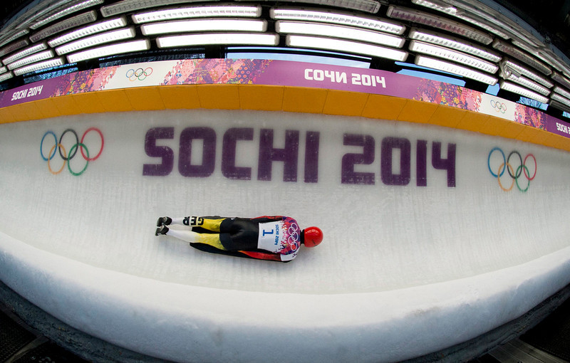 . In this image taken with a fisheye lens, Frank Rommel of Germany speeds down the track during the second heat of the men\'s skeleton competition at the 2014 Winter Olympics, Friday, Feb. 14, 2014, in Krasnaya Polyana, Russia. (AP Photo/The Canadian Press, Jonathan Hayward)