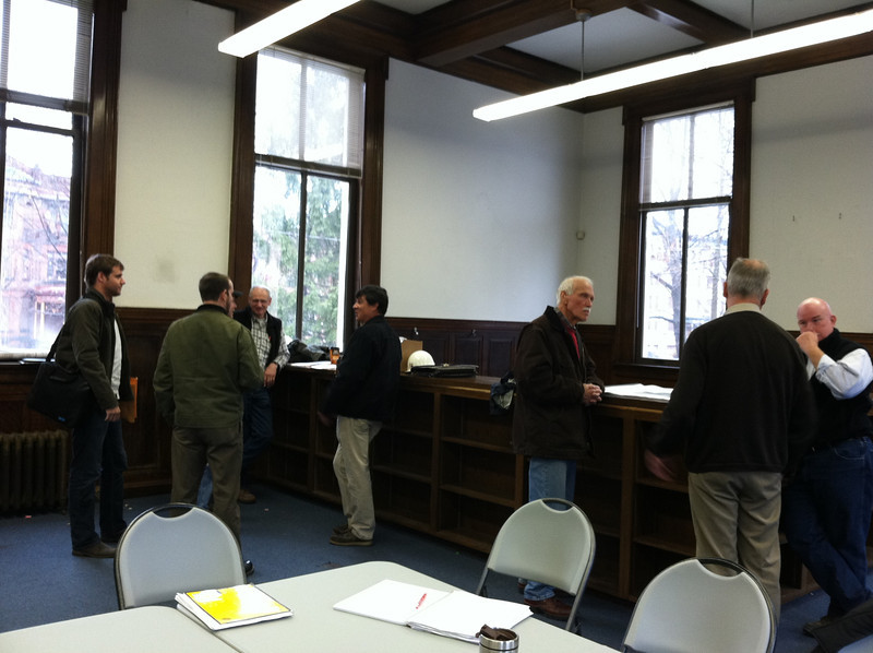 Meanwhile, back at the original Library, the Renovation Committee (a.k.a. the Building Committee) met with the contractors...     See the Construction Site album for photos of the ensuing work.