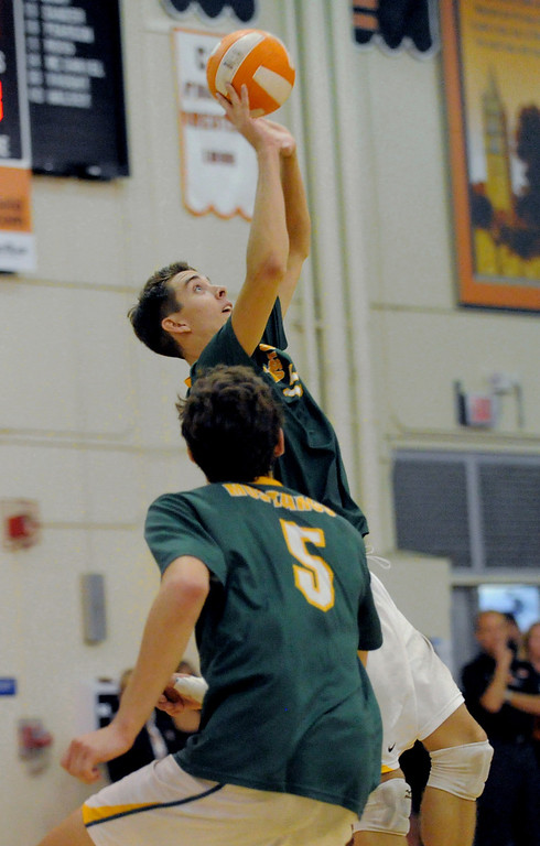 . 05-15-2013-( Daily Breeze Staff Photo by Sean Hiller) Huntington Beach swept Mira Costa in Wednesday\'s  boys volleyball CIF Southern Section Division I semifinal at Huntington Beach High School. Riley Mallon keeps the ball in play.