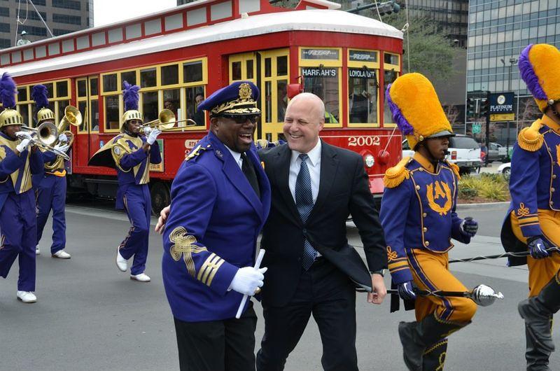 Loyola_Streetcar_Opening_Mitch_Landrieu_St_Aug_Purple_Knights.jpg