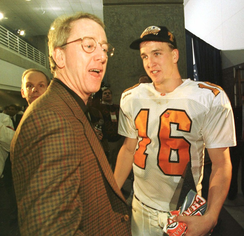 . Tennessee quarterback Peyton Manning, right, shares a laugh with his father Archie after Tennessee downed Auburn in the SEC Championship game in Atlanta Saturday, Dec. 6, 1997. (AP Photo/MOBIL REGISTER, John David Mercer)