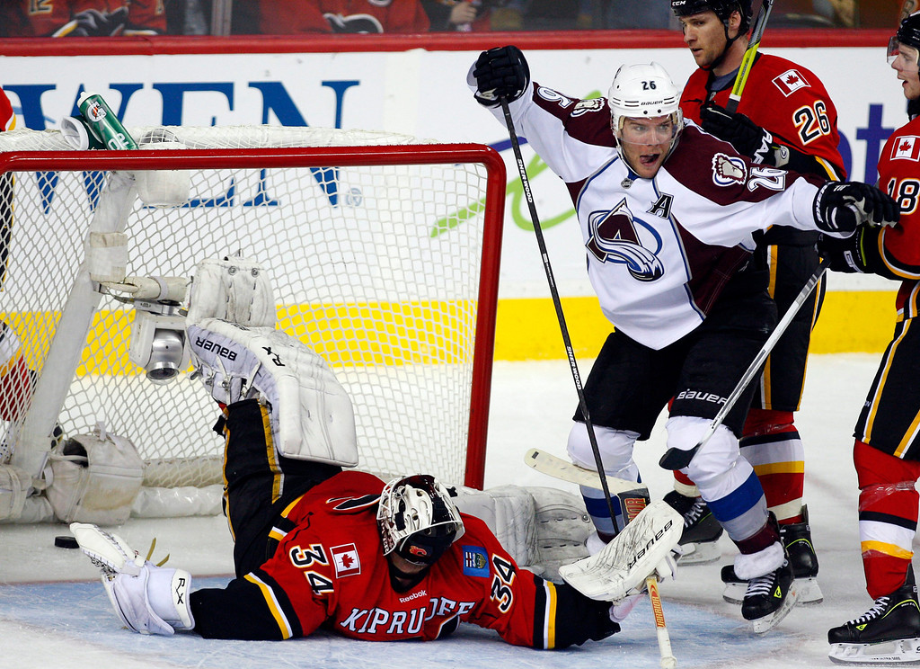 . Colorado Avalanche\'s Paul Stastny, right, celebrates scoring against Calgary Flames goalie Miikka Kiprusoff during the third period of an NHL hockey game Thursday, Jan. 31, 2013, in Calgary, Alberta. The Avalanche won 6-3. (AP Photo/The Canadian Press, Jeff McIntosh)