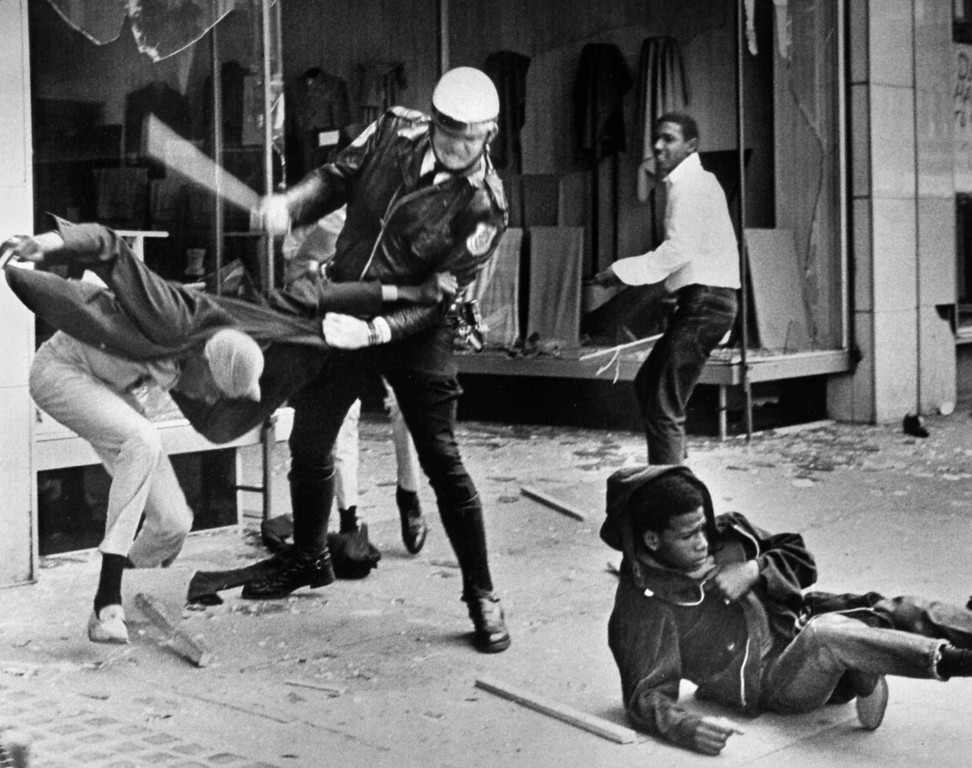. A police officer uses his nightstick on a youth reportedly involved in the looting that followed the breakup of a march led by Dr. Martin Luther King Jr. March 28, 1968, in Memphis, Tenn. Black leaders accused the police of brutality while police officers said they did what was necessary to restore order. In the wake of the violence, a curfew was imposed and more than 3,800 National Guardsmen were rushed to the city. A week later, King was assassinated at Memphis\' Lorraine Motel. (AP Photo/Jack Thornell)