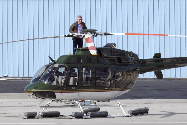 Harrison Ford Stands on the Roff of his Chopper