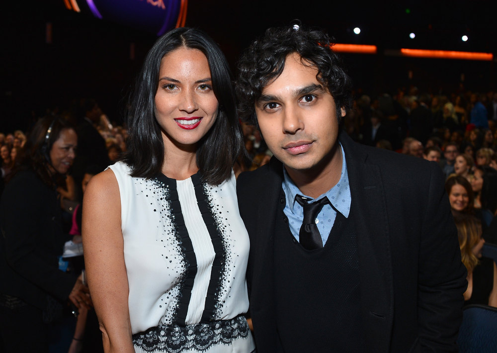 Description of . Actors Olivia Munn (L) and Kunal Nayyar attend the 39th Annual People's Choice Awards at Nokia Theatre L.A. Live on January 9, 2013 in Los Angeles, California.  (Photo by Frazer Harrison/Getty Images for PCA)