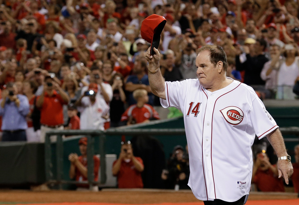 . Former Cincinnati Reds great Pete Rose walks onto the field during ceremonies honoring the starting eight of the 1975-76 World Series-champion Reds, following a baseball game between the Reds and the Los Angeles Dodgers, Friday, Sept. 6, 2013, in Cincinnati. (AP Photo/Al Behrman)