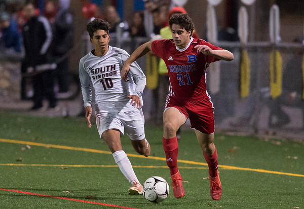 11/06/19 Wesley Bunnell | StaffrrBerlin boys soccer vs South Windsor on Wednesday evening at Sage Park. Marco Marino (21).