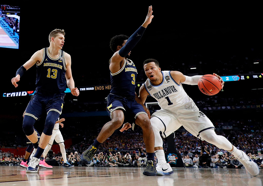 . Villanova\'s Jalen Brunson (1) drives against Michigan\'s Zavier Simpson (3) during the first half in the championship game of the Final Four NCAA college basketball tournament, Monday, April 2, 2018, in San Antonio. (AP Photo/Eric Gay)