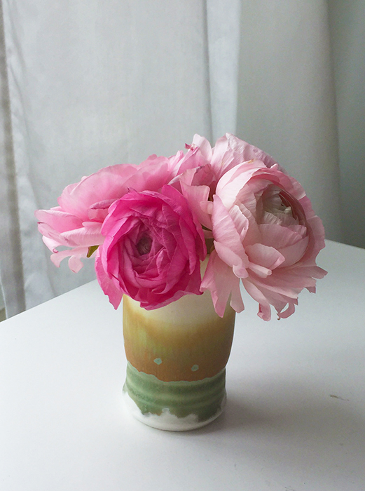 Ranunculus blooms in a tiny ceramic cup - www.beverlybrown.com