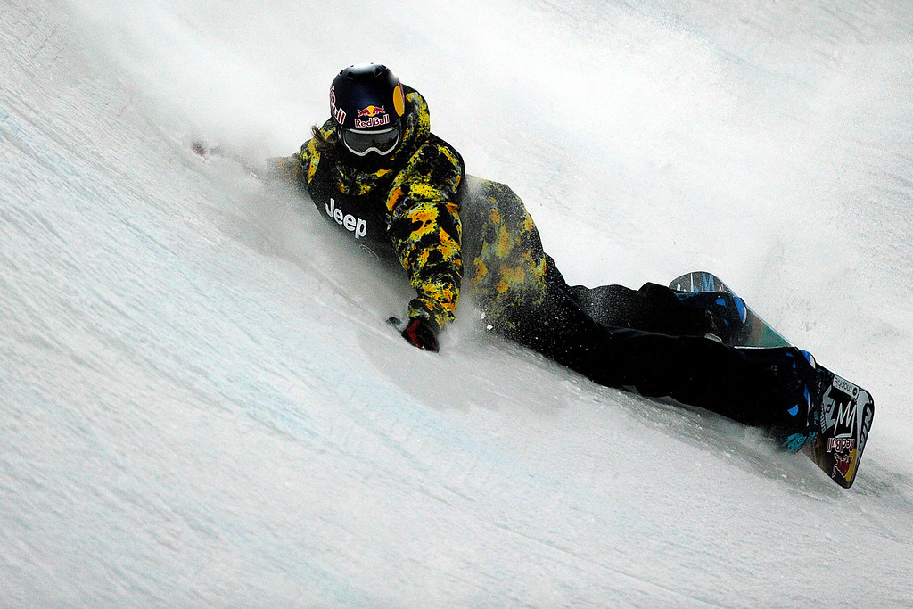 . ASPEN, CO - JANUARY 27: Greg Bretz takes a spill during the men\'s snowboard superpipe final. X Games Aspen Buttermilk Mountain Aspen January 27, 2013. (Photo By Daniel Petty/The Denver Post)