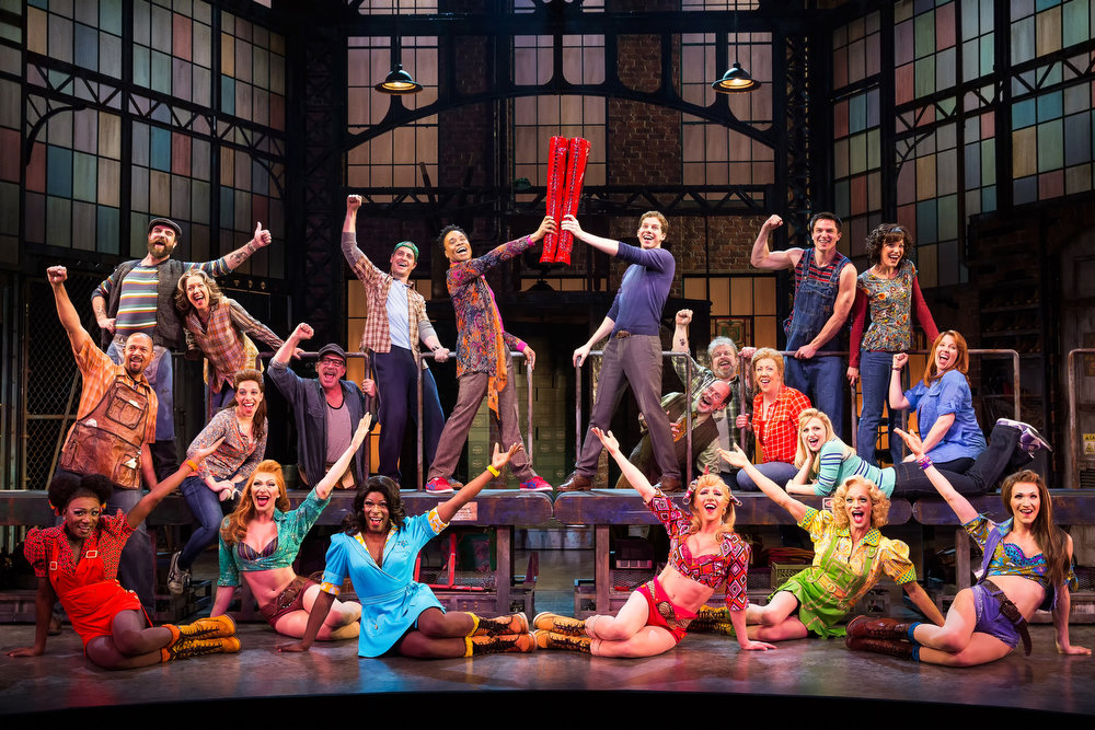 ". This theater image released by The O+M Company shows the cast during a performance of the musical ""Kinky Boots.\""  The Cyndi Lauper-scored \""Kinky Boots,\"" based on the 2005 British movie about a real-life shoe factory that struggles until it finds new life in fetish footwear, is nominated for 13 Tony Award nominations.  The awards will be broadcast on CBS from Radio City Music Hall on June 9. (AP Photo/The O+M Company, Matthew Murphy)"
