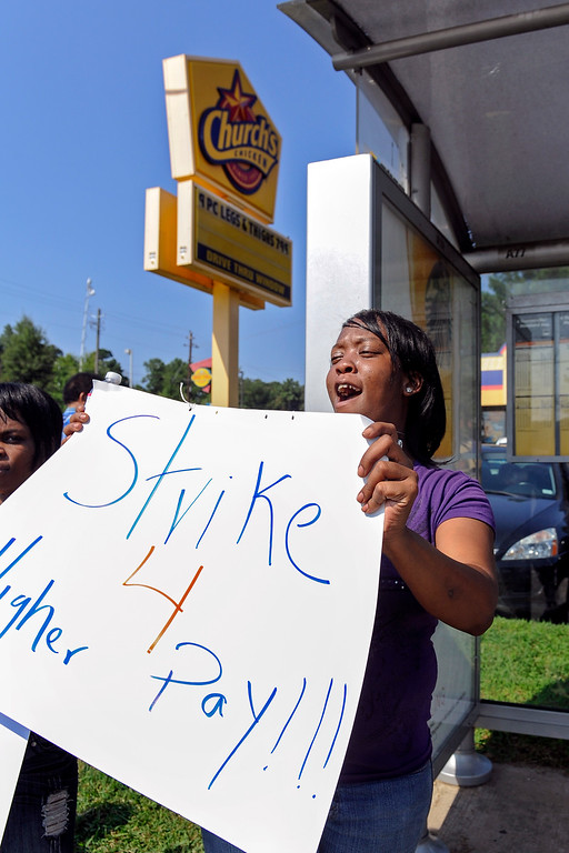. Church\'s Chicken employee Tina McCory protests low wages outside the fast food restaurant, Thursday, Aug. 29, 2013, in Atlanta. (AP Photo/John Amis)