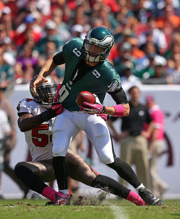 . Nick Foles #9 of the Philadelphia Eagles is sacked by Lavonte David #54 of the Tampa Bay Buccaneers during a game at Raymond James Stadium on October 13, 2013 in Tampa, Florida.  (Photo by Mike Ehrmann/Getty Images)