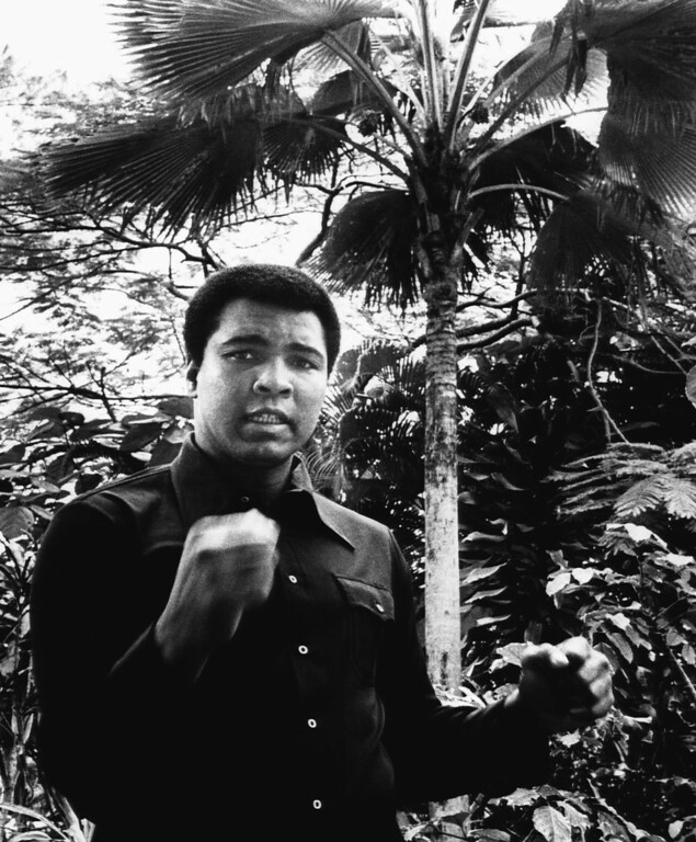. Heavyweight champion Muhammad Ali strikes a pose on Jan. 23, 1976 in the lush garden of a San Juan hotel where he is staying in preparation for his February 20 title defense against Jean Pierre Coopman, Belgian?s heavyweight champion. (AP Photo)