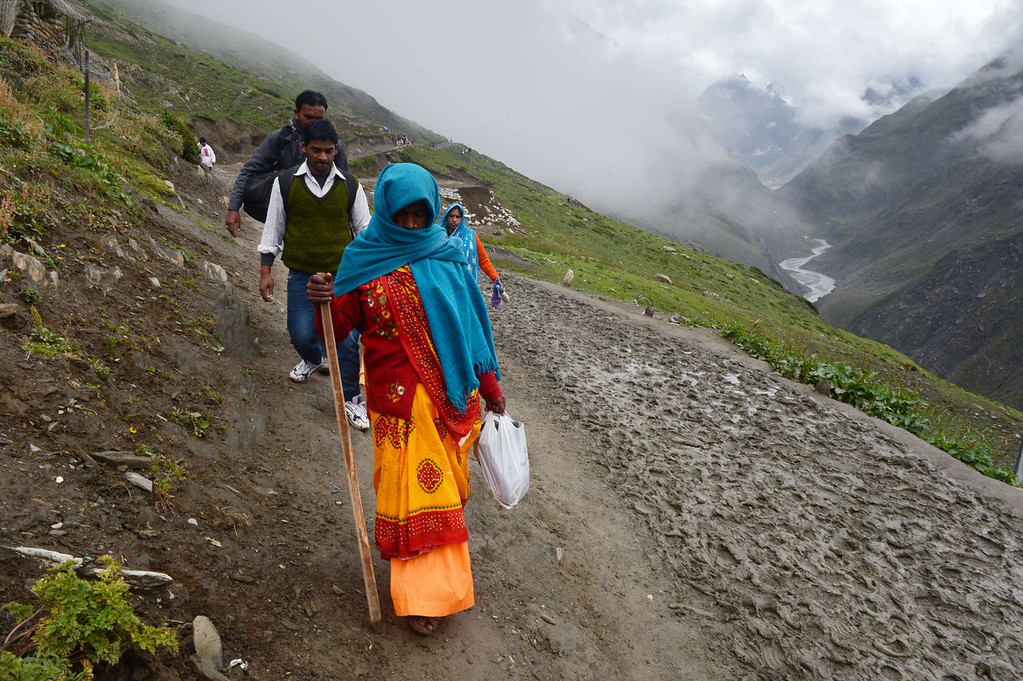 . Hindu devotees walk during their pilgrimage to the holy Amarnath Cave Shrine, in Bairey Marg on August 18, 2013. Every year, hundreds of thousands of pilgrims trek through treacherous mountains in revolt-torn Kashmir, along icy streams, glacier-fed lakes and frozen passes, to reach the Amarnath cave, located at an altitude of 3,857 meters (12,729 feet), where a Shiva Lingam, an ice stalagmite shaped as a phallus and symbolizing the Hindu God Shiva, stands for worship.   TAUSEEF MUSTAFA/AFP/Getty Images