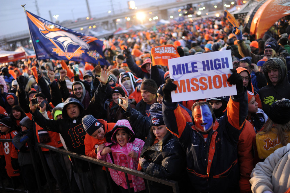 . Ken Castaneda holds the Mile High Mission sign as Denver Broncos fans attend the United in Orange Pep Rally at Sports Authority Field at Mile High in Denver on Friday. Denver. CO, January 11, 2013.  Hyoung Chang, The Denver Post