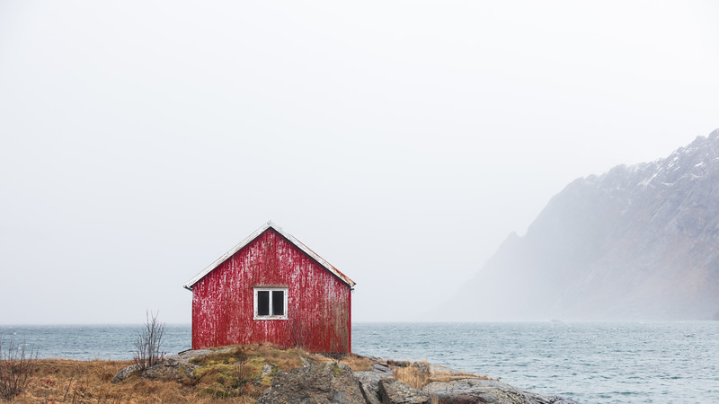 Red Cabin hut Lofoten water fjord sea norway.jpg