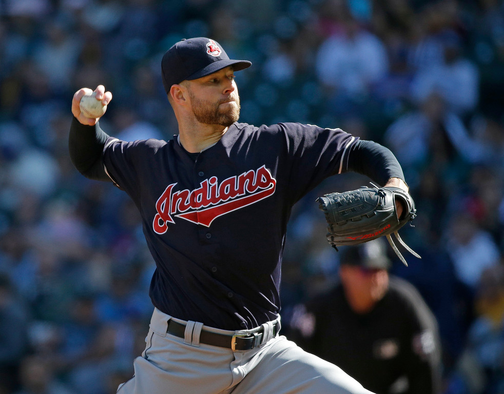 . Cleveland Indians starting pitcher Corey Kluber throws against the Seattle Mariners during the first inning of a baseball game, Sunday, Sept. 24, 2017, in Seattle. (AP Photo/Ted S. Warren)