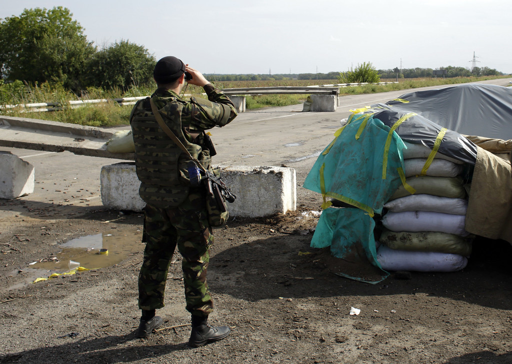 . A Ukrainian soldier guards at a checkpoint controlled by Ukrainian forces on September 10, 2014, near the small eastern Ukrainian city of Slavyanoserbsk, in the Lugansk region. AFP PHOTO/ ANATOLII STEPANOVANATOLII STEPANOV/AFP/Getty Images