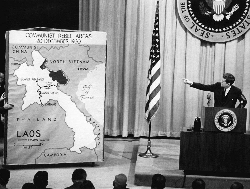 """. President Kennedy points to a map of Laos during a press conference in March 1961, saying that the communist threat to Laos wass \""""difficult and potentially dangerous.\""""     STF/AFP/Getty Images"""