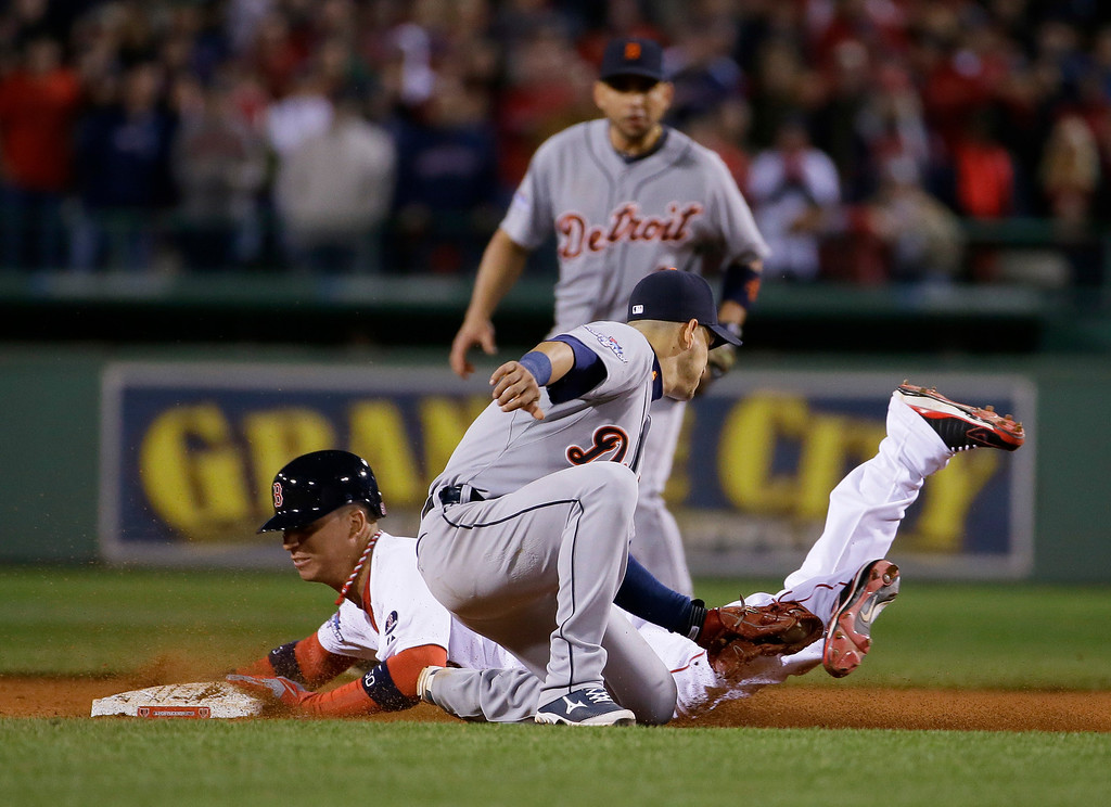 . Boston Red Sox pinch runner Quintin Berry steals second before Detroit Tigers shortstop Jose Iglesias, front, can make the tag in the ninth inning during Game 1 of the American League baseball championship series Sunday, Oct. 13, 2013, in Boston. (AP Photo/Matt Slocum)