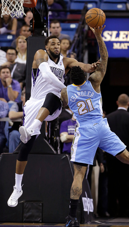 . Denver Nuggets forward Wilson Chandler, right, is fouled by Sacramento Kings forward Derrick Wilson during the third quarter of an NBA basketball game in Sacramento, Calif., Sunday, Jan. 26, 2014. The Nuggets won 125-117.(AP Photo/Rich Pedroncelli)