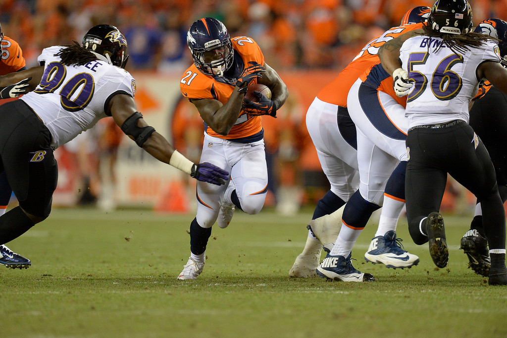 . Denver Broncos running back Ronnie Hillman (21) runs through a hole in the line in the third quarter. The Denver Broncos took on the Baltimore Ravens in the first game of the 2013 season at Sports Authority Field at Mile High in Denver on September 5, 2013. (Photo by John Leyba/The Denver Post)