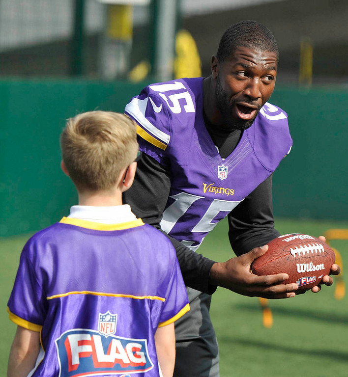 . Vikings wide receiver Greg Jennings coaches during a football clinic.  (NFL: Sean Ryan)