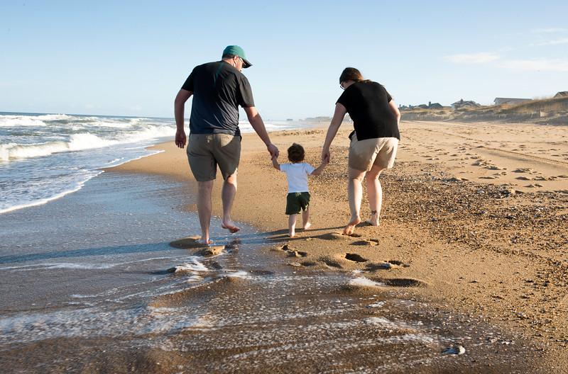 Jesse Holly Caleb Walking down the beach.jpg