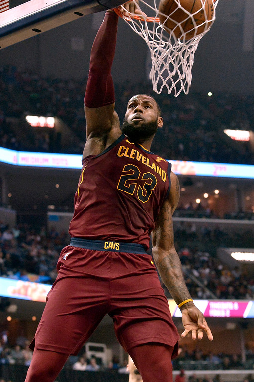. Cleveland Cavaliers forward LeBron James (23) dunks during the first half of the team\'s NBA basketball game against the Memphis Grizzlies on Friday, Feb. 23, 2018, in Memphis, Tenn. (AP Photo/Brandon Dill)