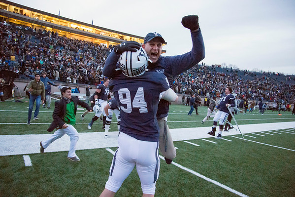 11/23/19 Wesley Bunnell | StaffrrYale rallied late in The Game against Harvard on Saturday afternoon at the Yale Bowl for a 50-43 victory in double over time. DL Sean Kissel (94) lifts a coach up in the air following the victory.