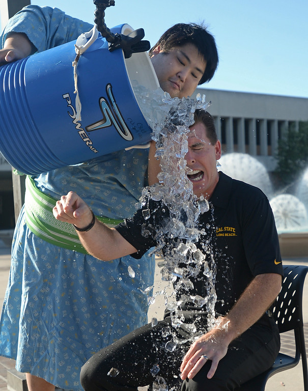 . Cal State Long Beach Dean of Students Jeff Klaus takes the ice bucket challenge as visiting Japanese Sumo wrestler Yama dumps the bucket Thursday, August 21, 2014, Long Beach, CA.  Yama, a famous Sumo wrestler in Japan, is visiting the campus in part to promote championships at the Pyramid in September. Yama weighs in at over 600 pounds and is considered the largest Japanese person in history. Photo by Steve McCrank/Daily Breeze
