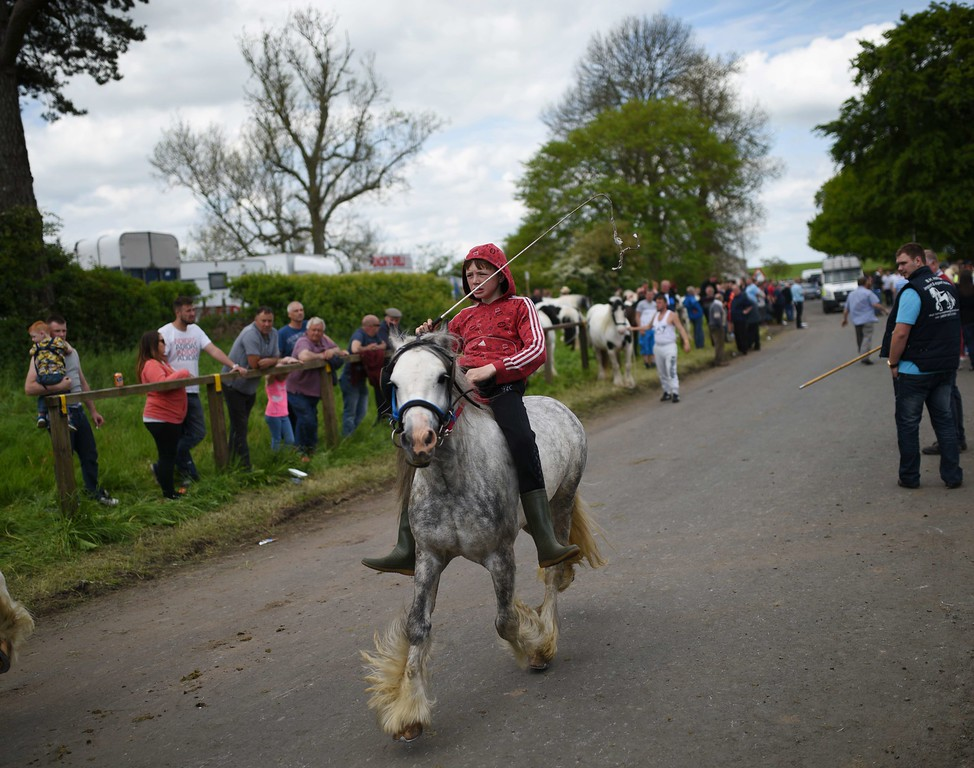 . A boy shows off a horse on the opening day of the annual Appleby Horse Fair, in the town of Appleby-in-Westmorland, North West England on June 4, 2015. The annual event attracts thousands of travelers from across Britain to gather and buy and sell horses. AFP PHOTO / OLI SCARFF/AFP/Getty Images